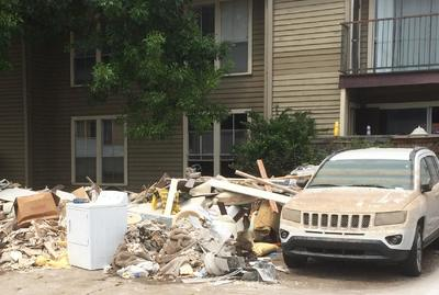 Pile of Debris Behind Apartment Complex